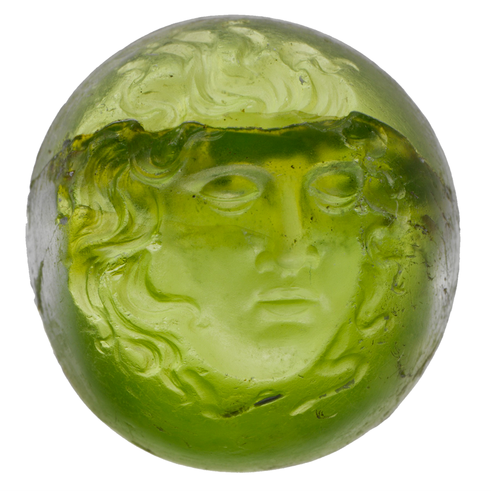 A peridot ring stone depicting a sleeping woman.
